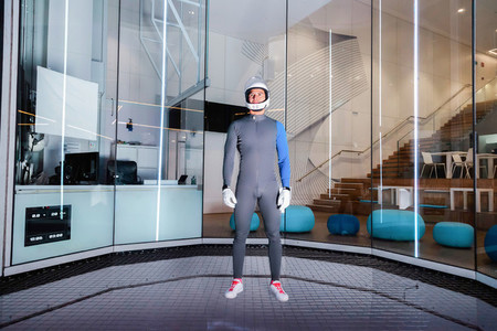 A flying serious man are prepared to fly in the wind tunnel