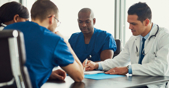 Young male doctor on medical staff meeting