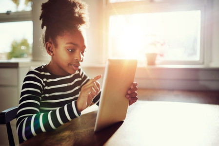 Afro American Girl Surfing Internet Using Tablet