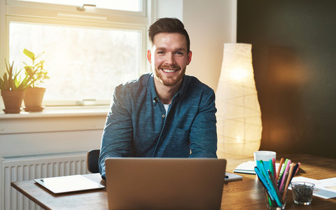 Entrepreneur at office with laptop