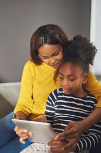 Afro american woman and child with tablet