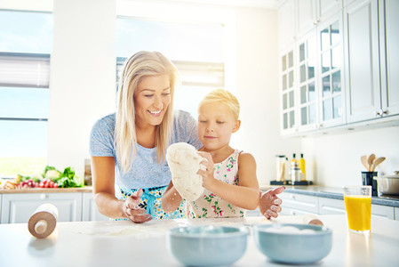 Cute little girl learning to bake cookies