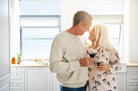 Elderly retired couple sharing a tender moment