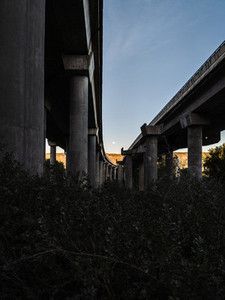 Full moon at the end of a concrete bridge in the afternoon
