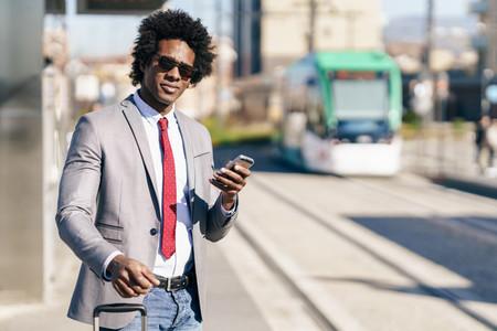Black Businessman waiting for the next train