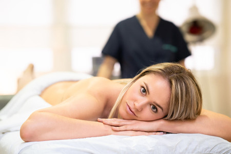 Woman lying on a stretcher at a physical therapy center