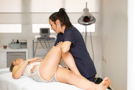 Physiotherapist inspecting her patient in a physiotherapy center