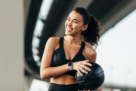 Beautiful woman holding ball