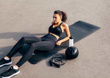 Female in sportswear lying down