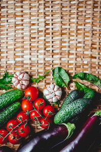 Various fresh vegetables on a rattan background Healthy eating and cooking concept