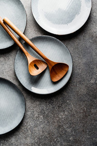 Empty blue ceramic food set with plates and wooden kitchen utensils Minimalist style top view