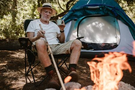 Senior having leisure time at campsite