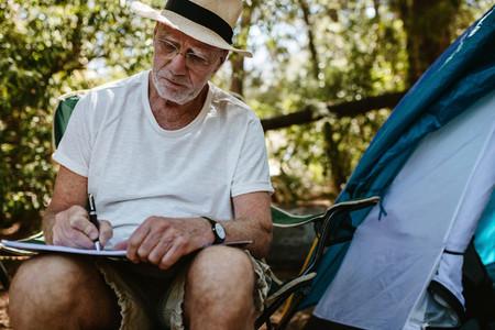Traveller writing a book