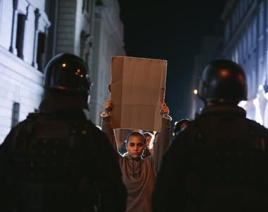 Demonstrators protesting in front of policemen