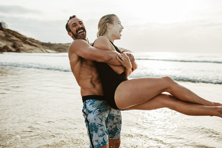 Couple having a great time on the beach vacation