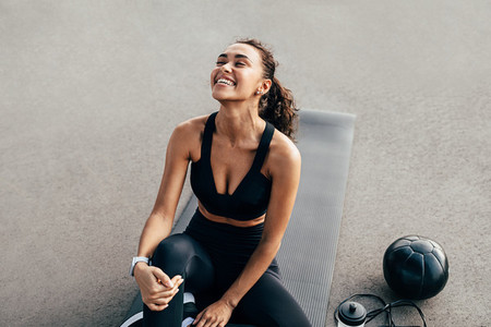 Laughing sport woman sitting