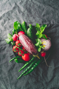 Top view of different fresh colorful vegetables in a plate on a table  Healthy eating concept