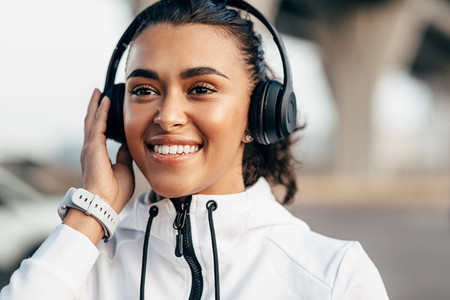 Female athlete with headphones