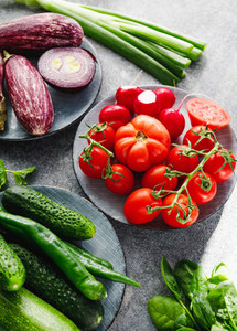 Tomatoes and different fresh vegetables on a table Harvest and healthy eating vegetarian concept