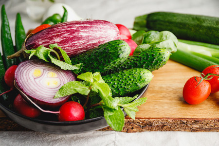 Different fresh colorful vegetables on a wooden tray  Close up view  healthy eating