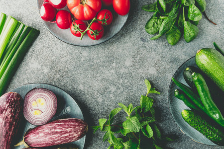 Green  red and purple various fresh vegetables on a table  Healthy eating concept  Flat lay  top view