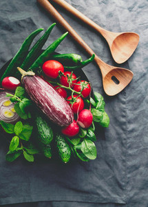 Various fresh colorful vegetables on a table Top view