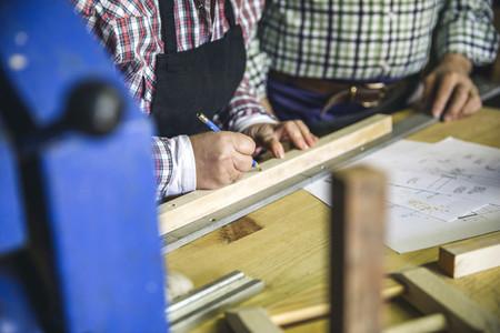 Unrecognizable senior couple in a carpentry