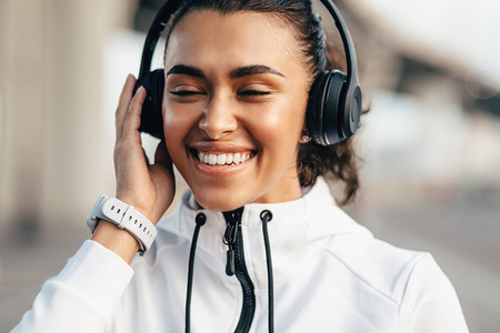 Happy woman enjoying music