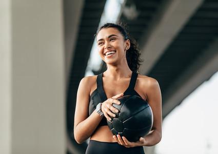 Beautiful woman holds a ball