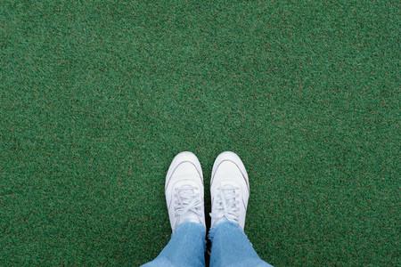 Selfie of feet in sneakers shoes
