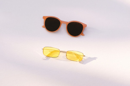 Flat lay summer fashion accessories concept of two sunglasses on