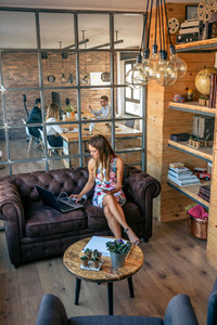 Businesswoman working with laptop in a coworking office