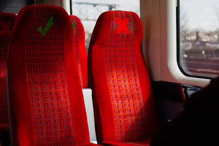 Train seats with warning marks for social distancing due to coronavirus