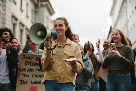Woman with a megaphone in a rally