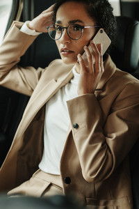 Businesswoman traveling by and talking on phone