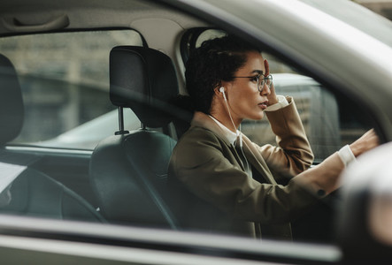 Woman in her daily life driving the car to work