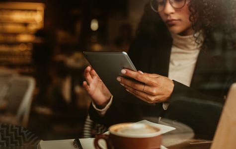 Businesswoman using cafe wifi