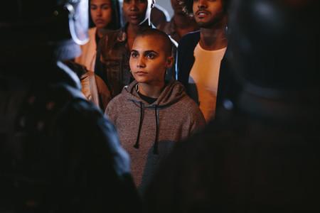 Woman activists staring at a policeman