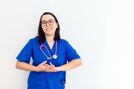Doctor woman isolated on withe background gesturing and smiling
