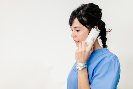 Nurse talking on phone in the clinic