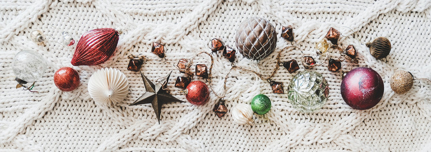 Christmas decoration toys and balls over woolen background  wide composition