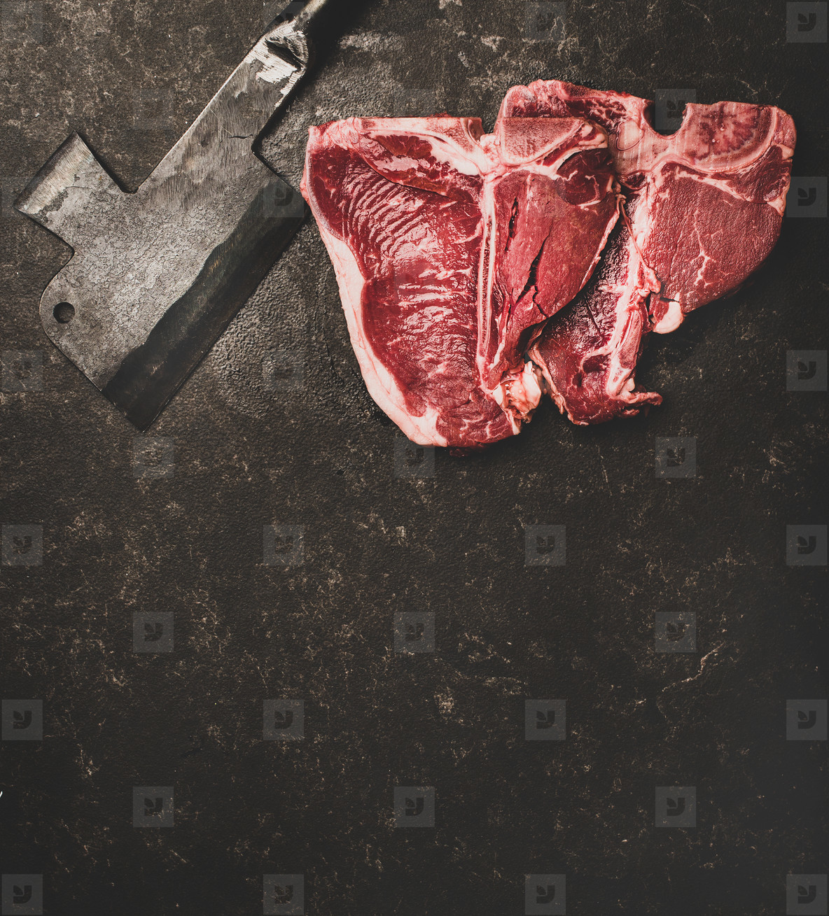 Fresh uncooked beef meat t bone steaks and cleaver  copy space