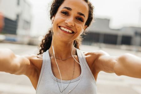Happy fitness woman taking selfie