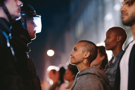 Woman smiling at the policeman during a rally