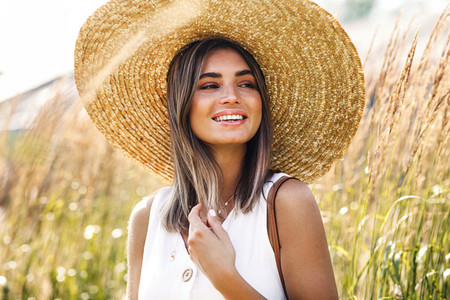 Beautiful smiling woman in hat
