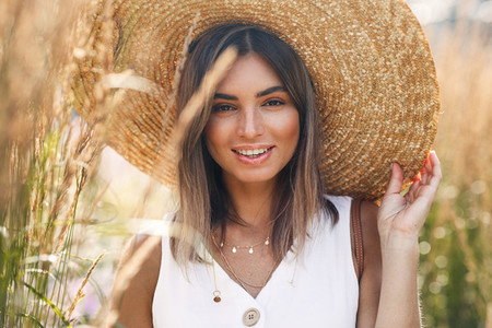 Cheerful female wearing a hat