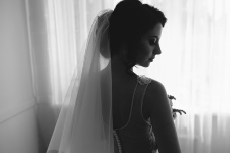 Bride posing in a large window