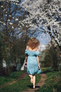 Beautiful girl walks in garden