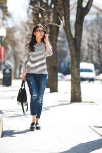 Beautiful model walks with phone