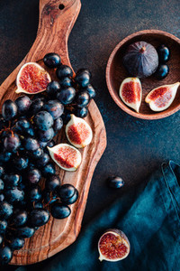 Autumn food still life with blue grape and ripe figs